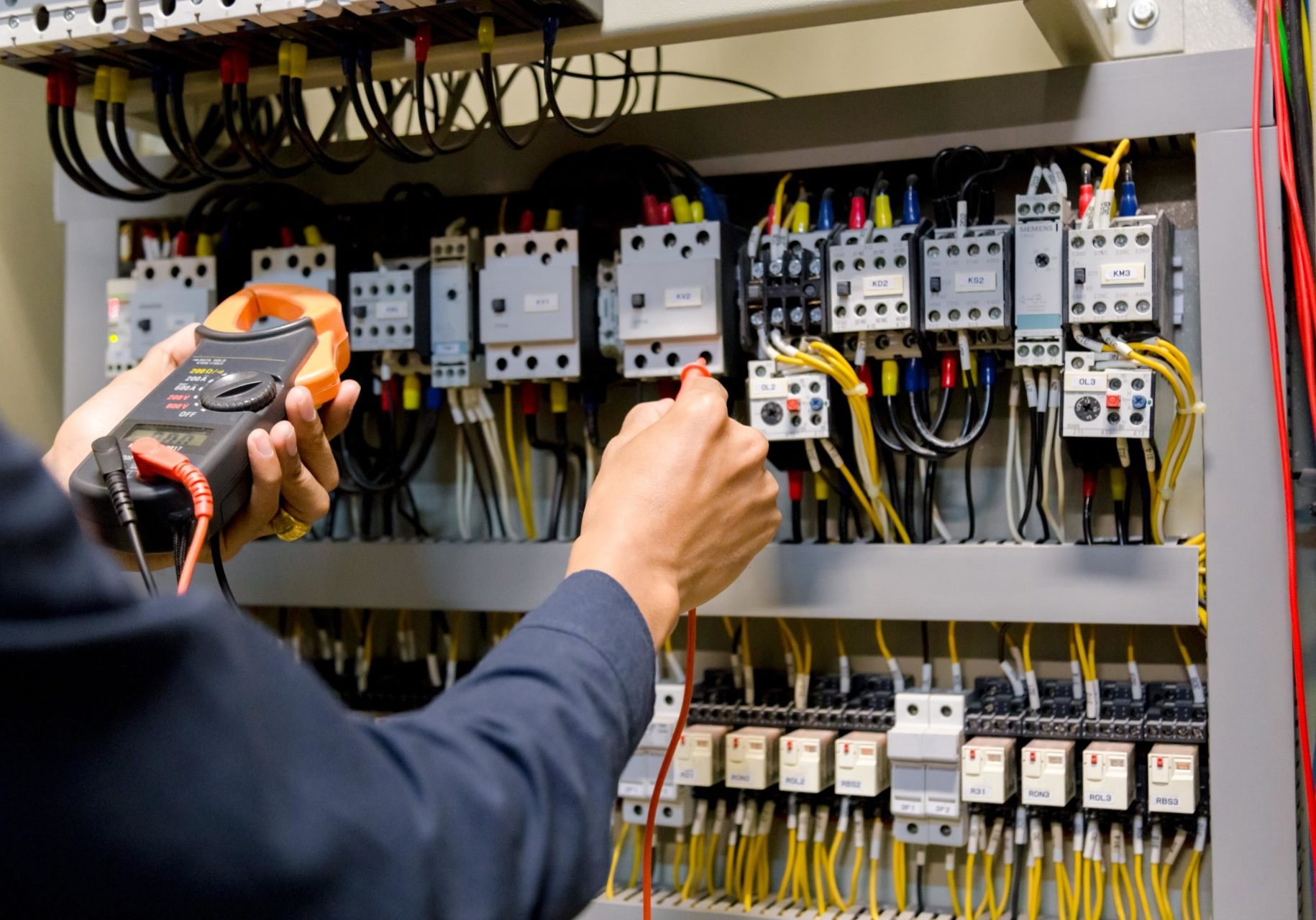 electrician-engineer-work-tester-measuring-voltage-and-current-of-power-electric-line-in-electical-cabinet-control-min
