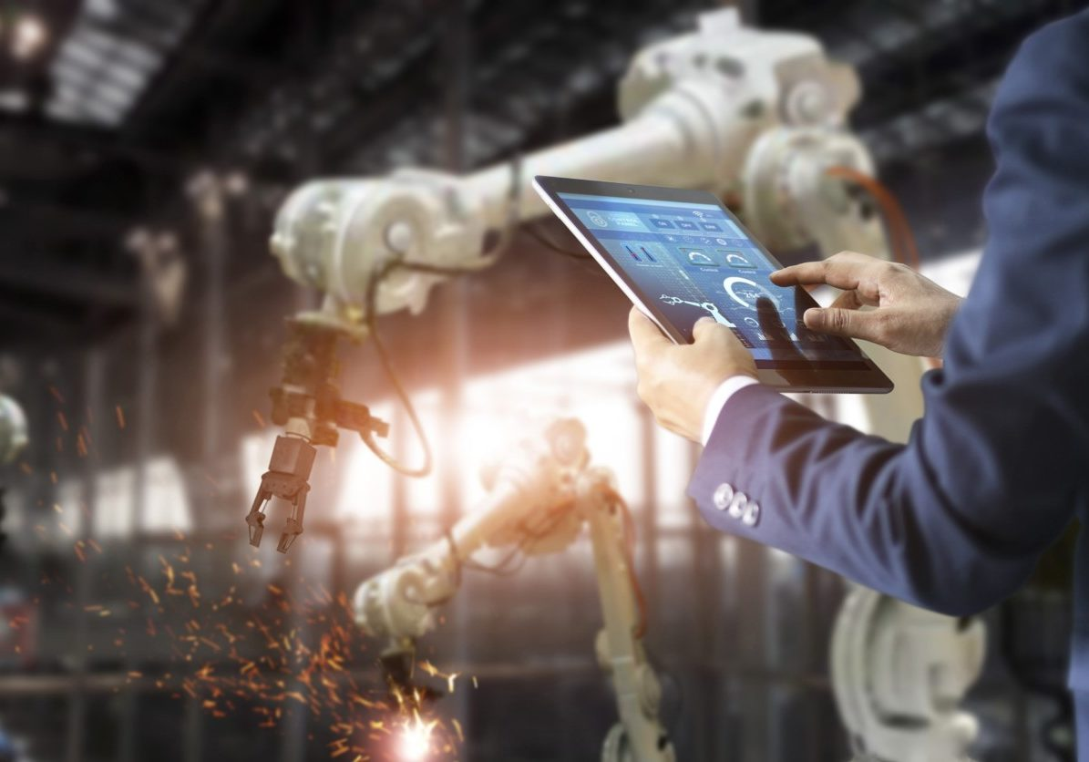 manager-industrial-engineer-using-tablet-check-and-control-automation-robot-arms-machine-min